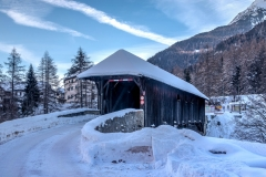 Covered bridge in Lavin, Swiss Alps