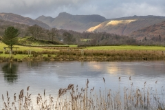 The Langdale Pikes beyond the River Brathay