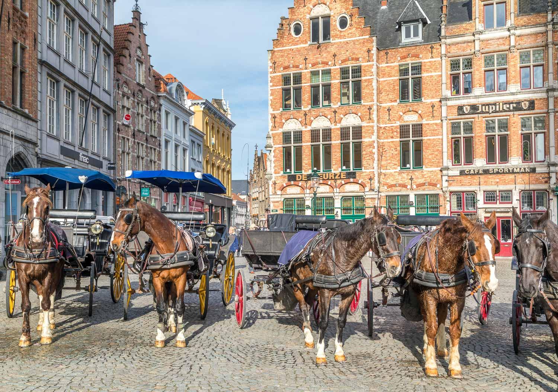 Markt Bruges, horse drawn carriages